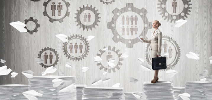 woman standing on top of court documents with statistics logos above her
